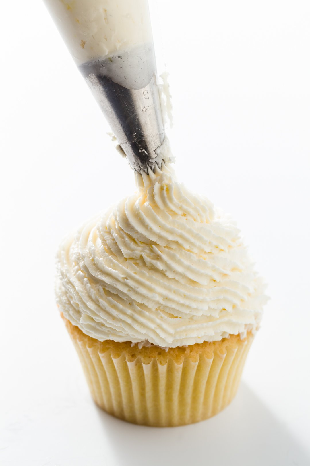 Piping lemon buttercream frosting