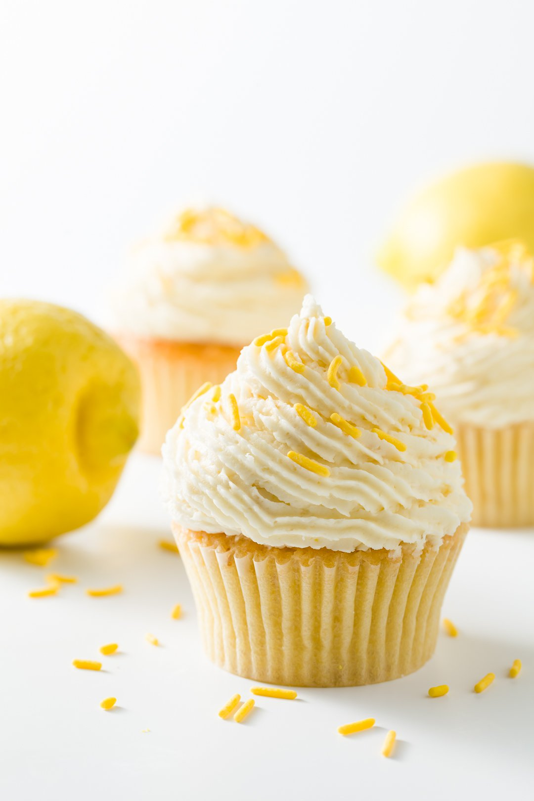 Several lemon cupcakes decorated with lemon buttercream frosting