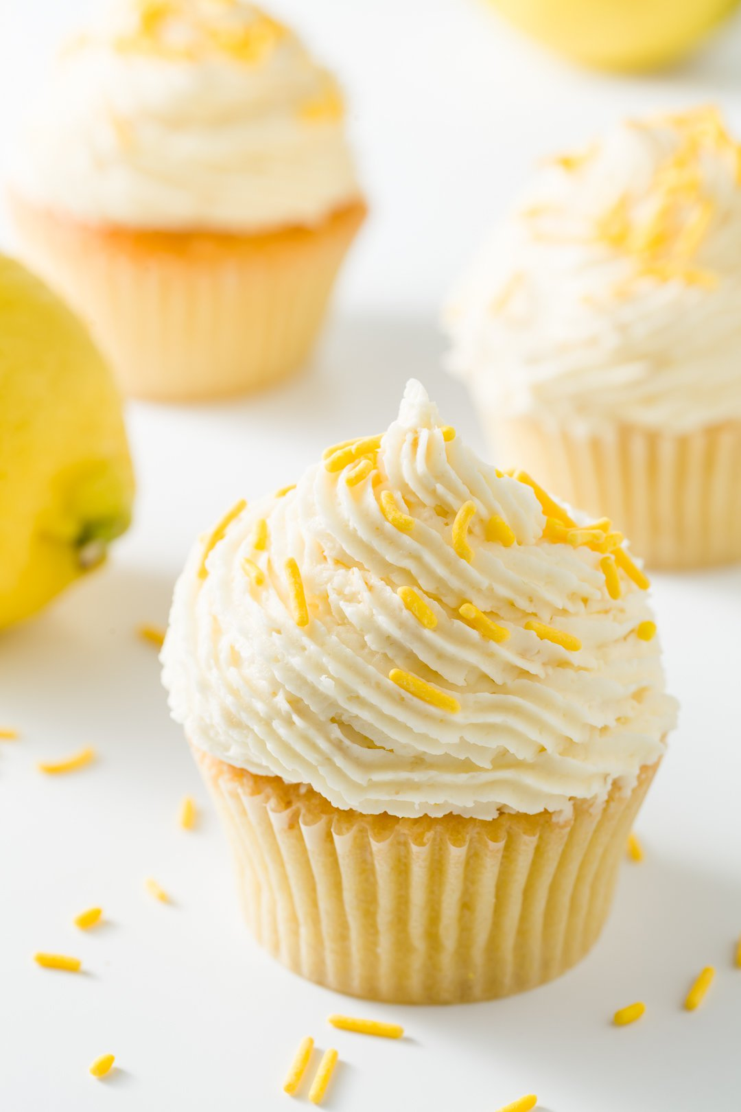 Several cupcakes frosted with lemon buttercream frosting
