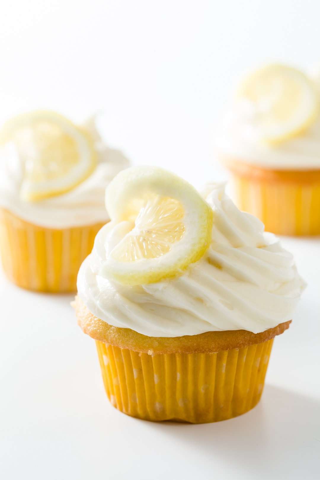 Lemon cream cheese frosting on a few cupcakes