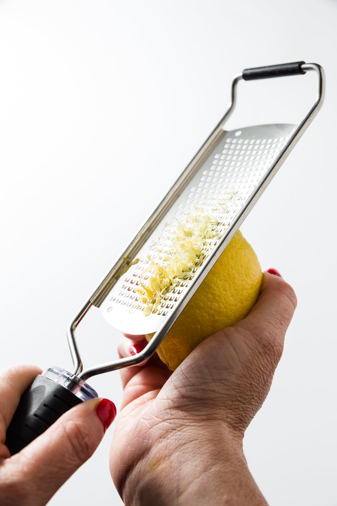 Zesting a lemon with a microplane