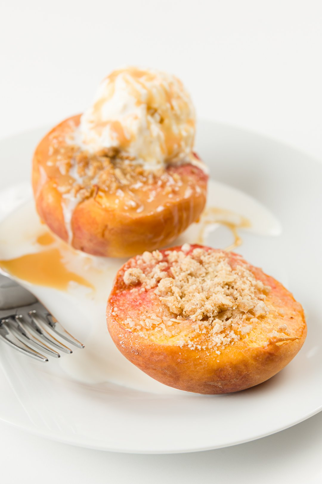 Baked Peaches with crumb topping and ice cream