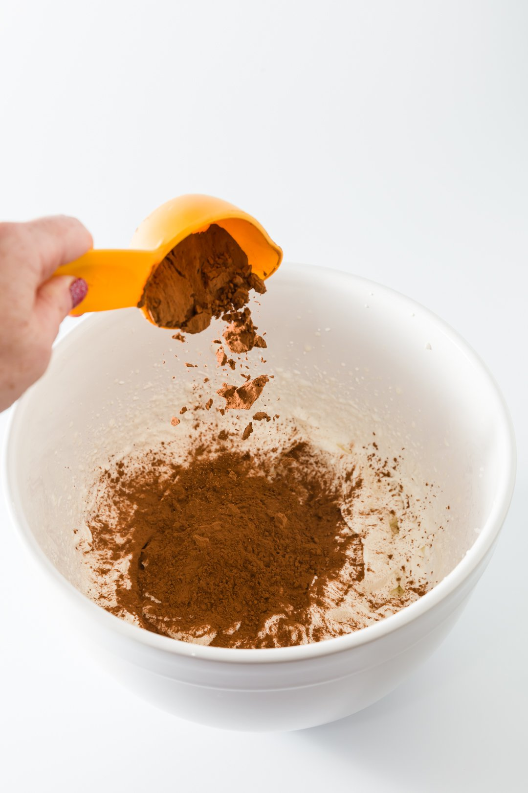 Adding cocoa powder to chocolate whipped cream