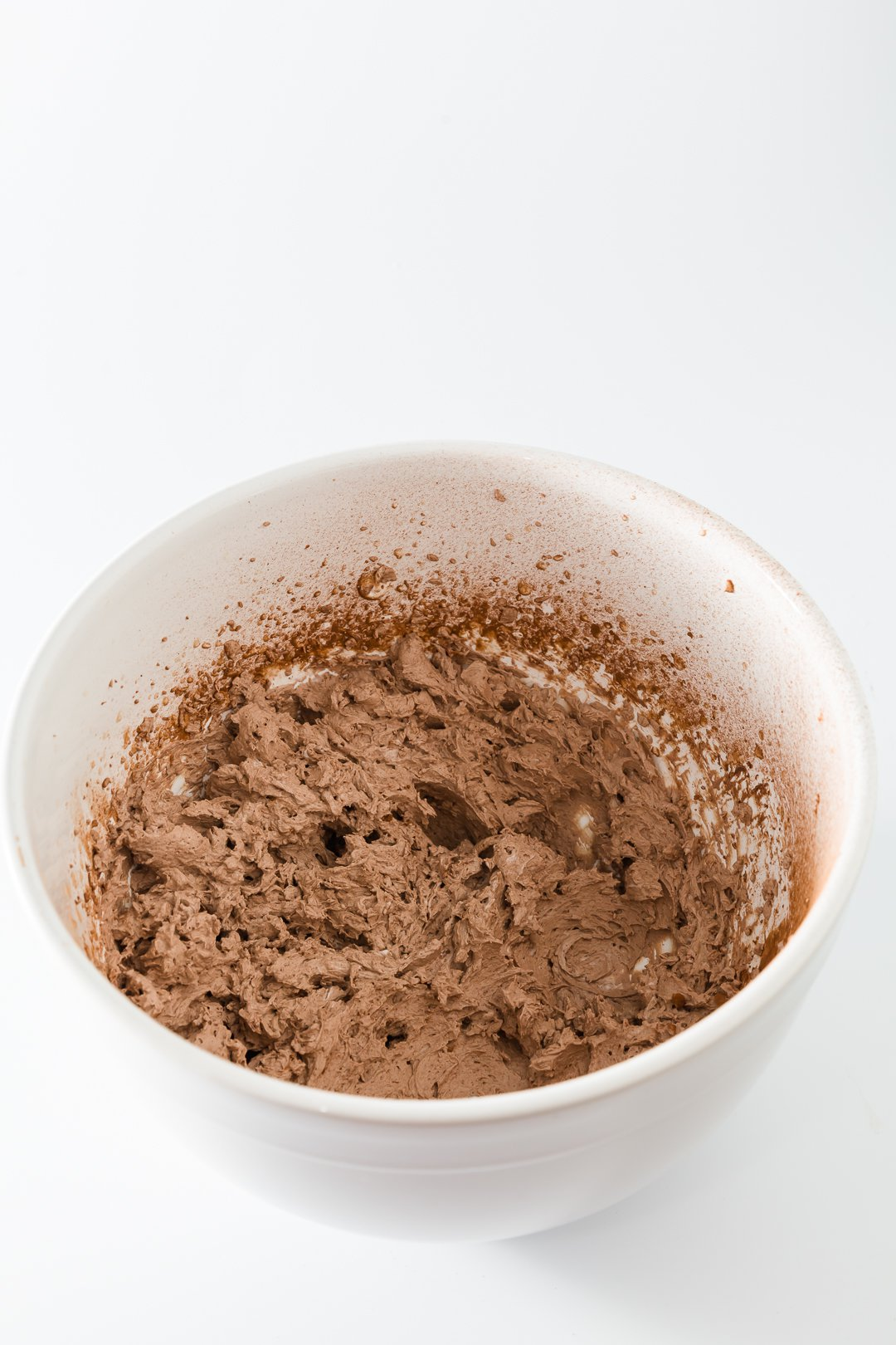 Chocolate whipped cream in a mixing bowl