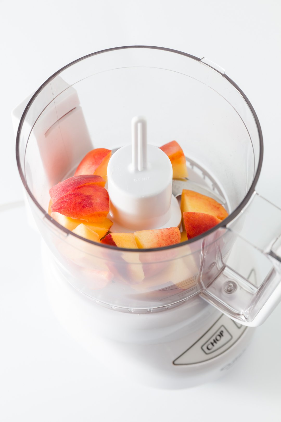 Chunks of peaches in a food processor