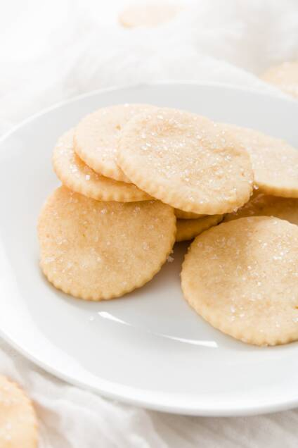 White plate filled with a pile of honey cookies
