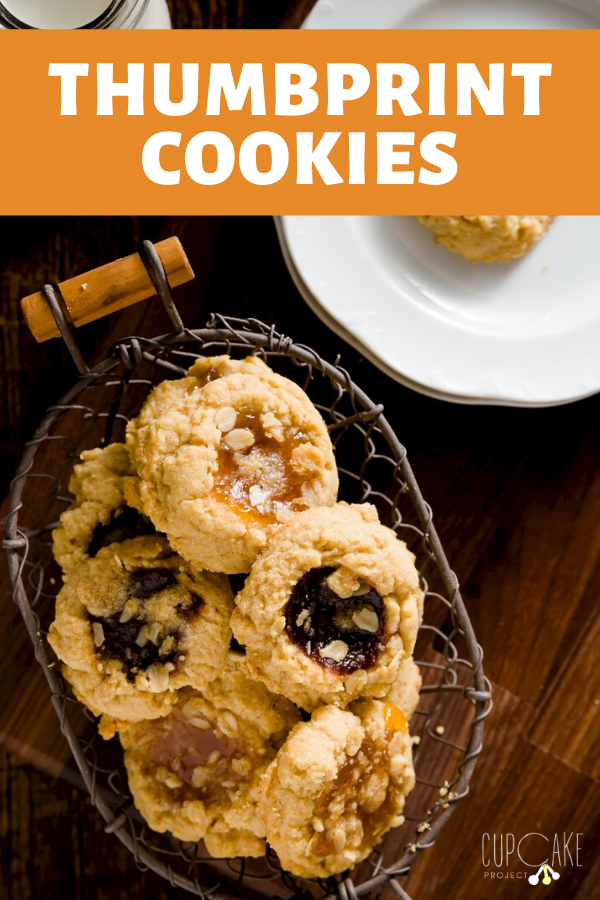 Thumbprint cookies are classic buttery, rich holiday cookies filled with jam. This easy recipe is a hit every single time. Whether you make raspberry thumbprint cookies, chocolate, or strawberry, you can't go wrong. #holidaycookies #thumbprintcookies