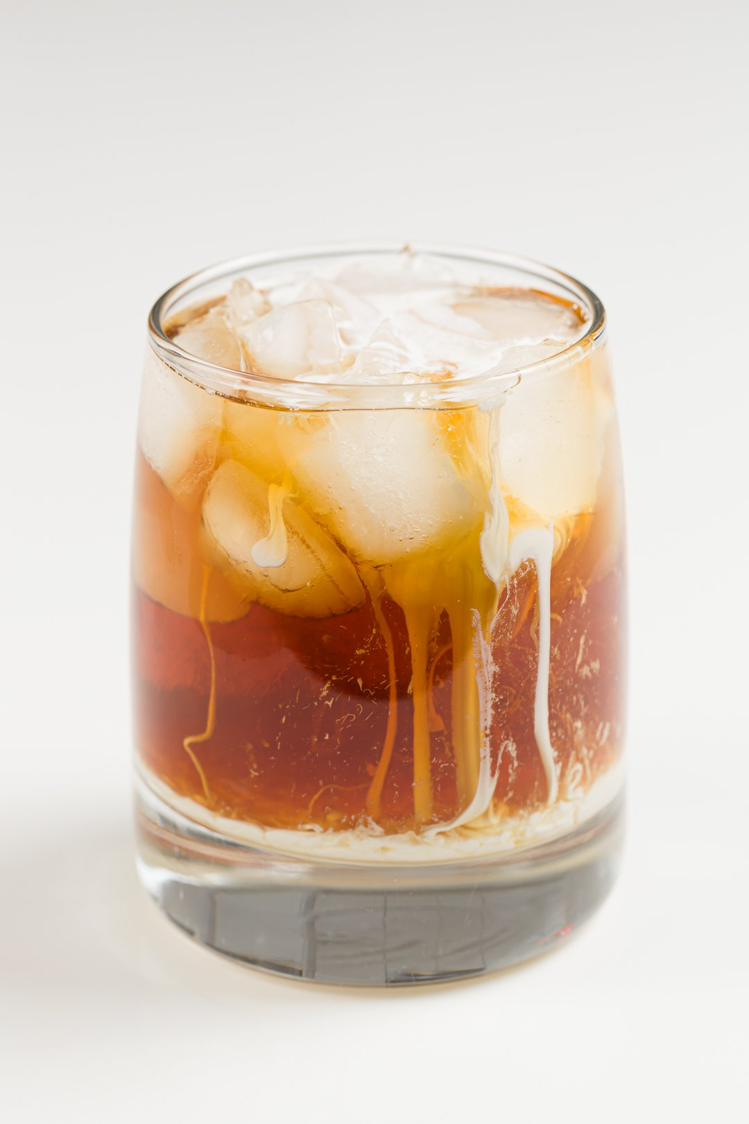 glass with a White Russian cocktail made with homemade Kahlua