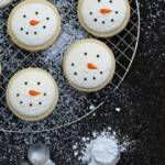 Snowmen cookies on a cooling rack