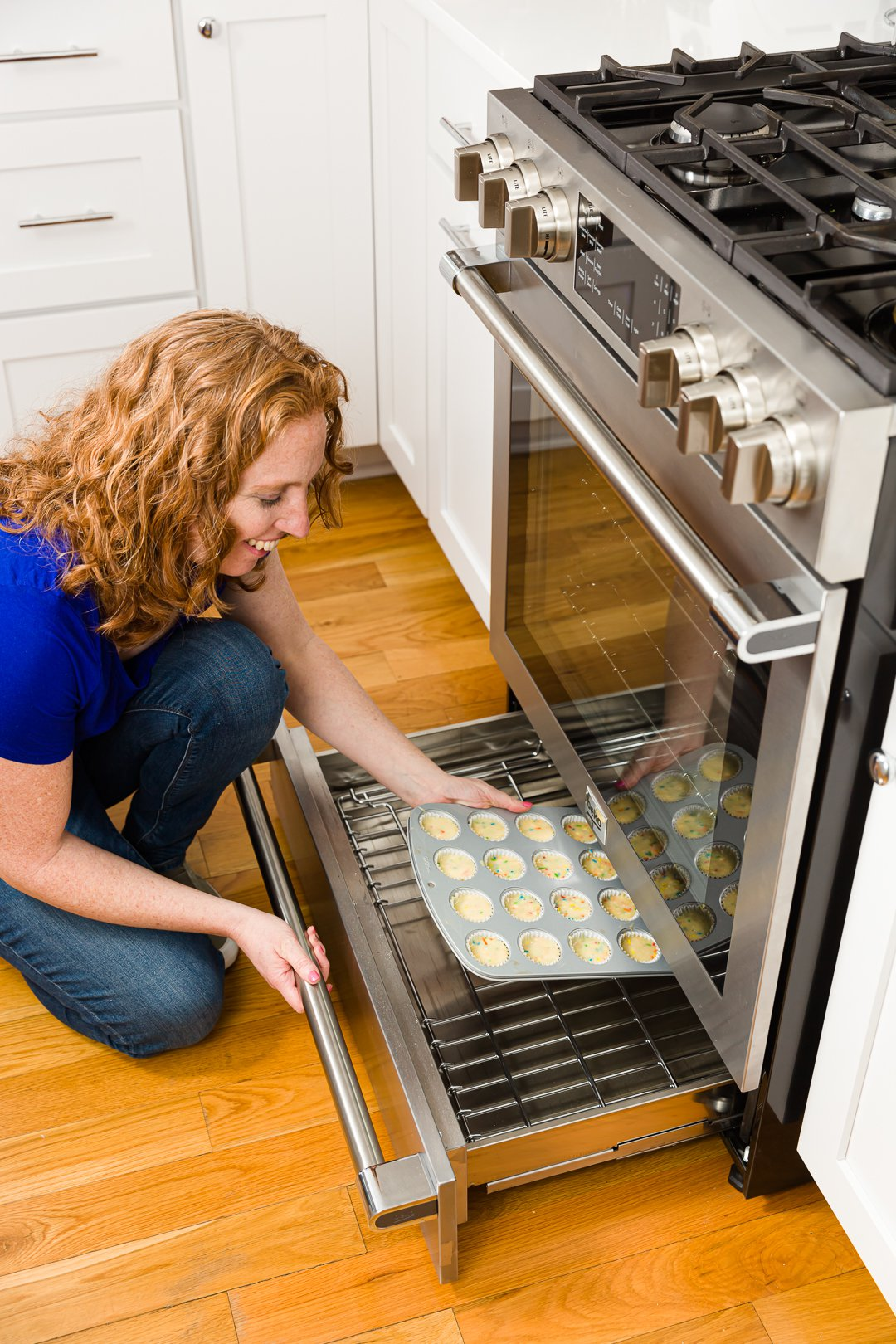 Loading cupcakes into the oven