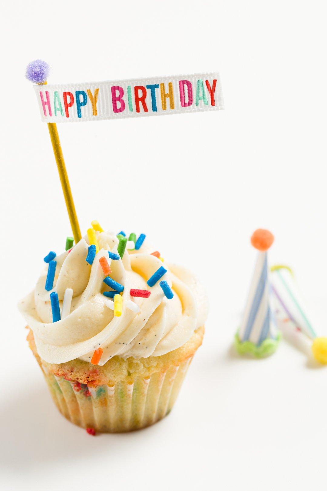 Happy birthday banner on a birthday cupcake