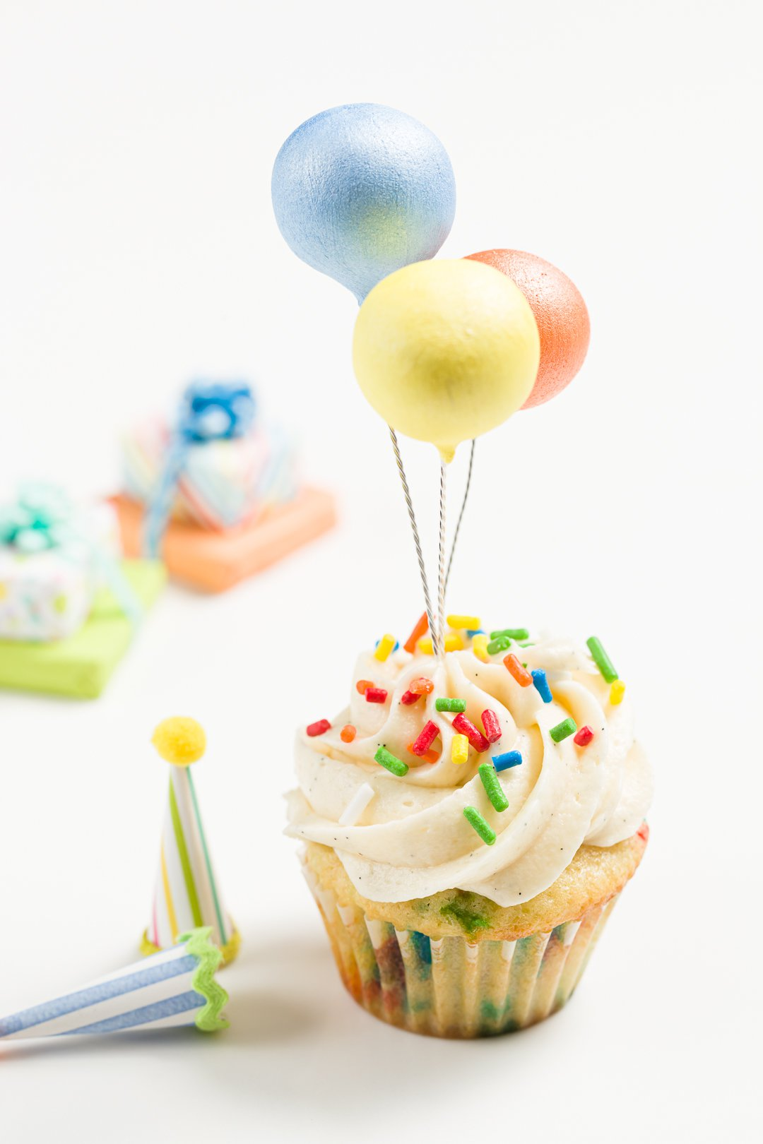 Birthday cupcake topped with balloons