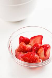 A bowl of glistening macerated strawberries