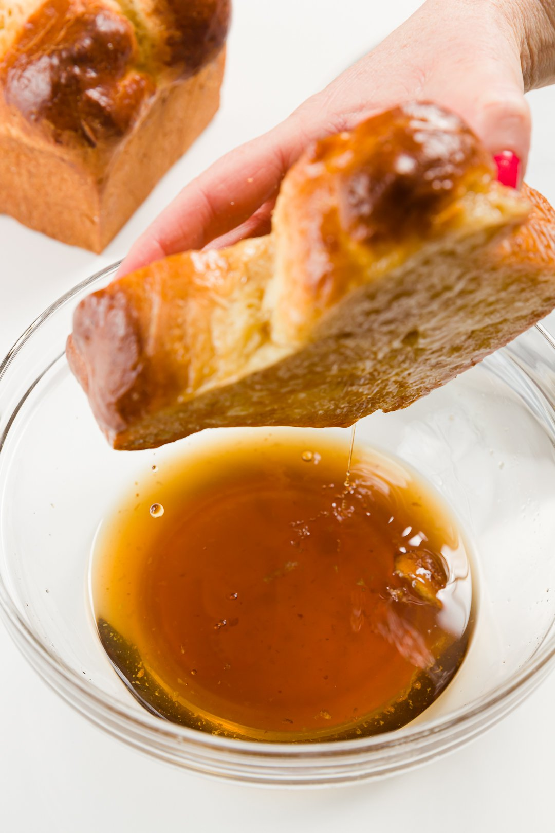 Dipping in almond syrup