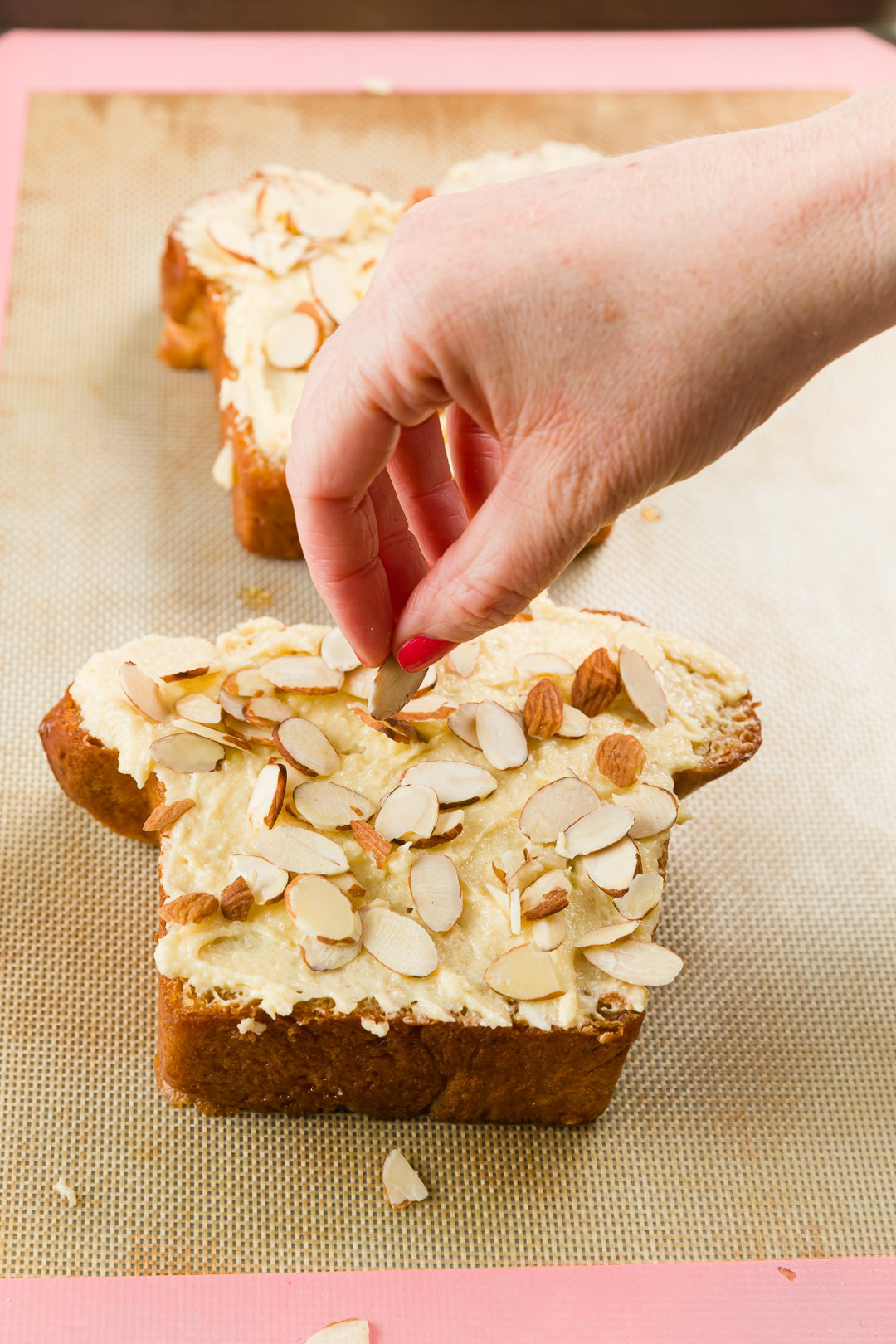 Sprinkling almonds on bostock