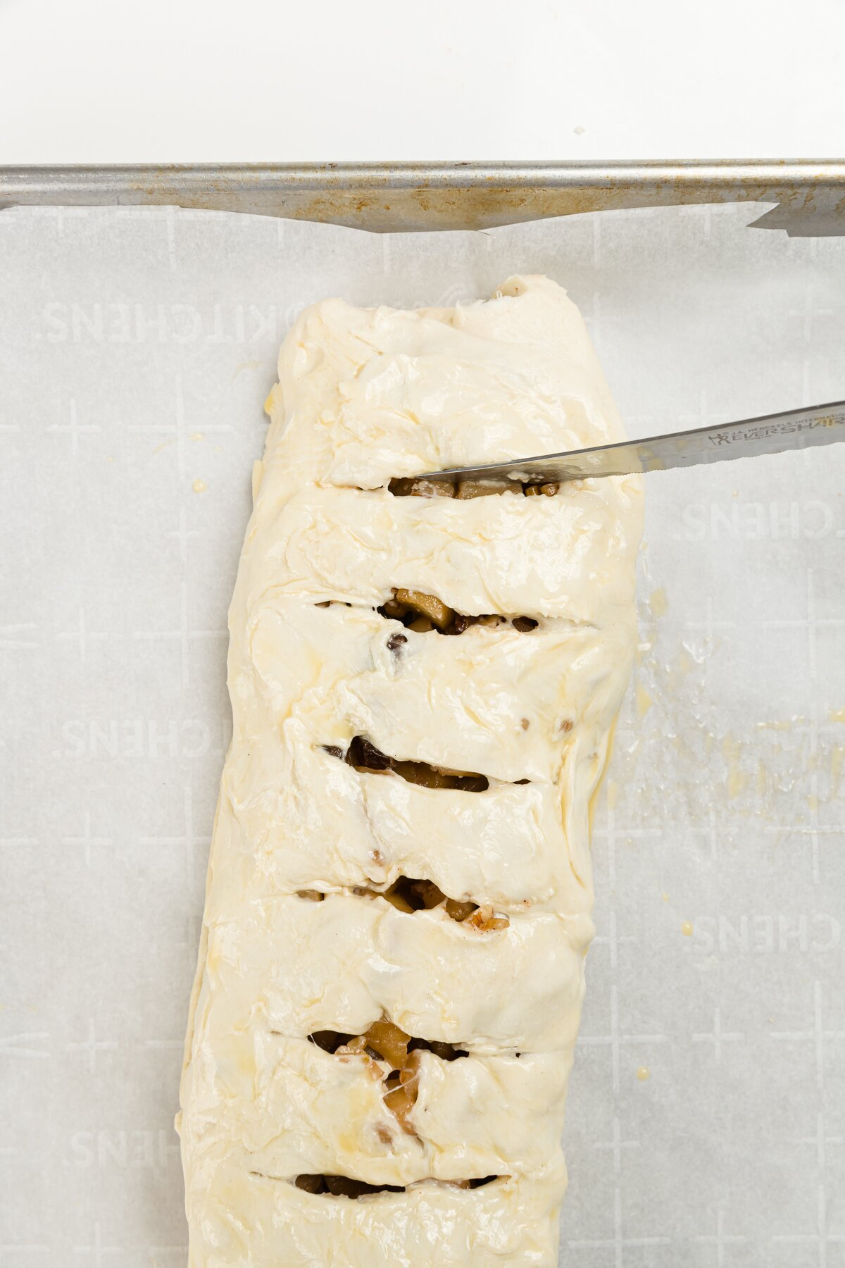 Cutting slits into rolled puff pastry