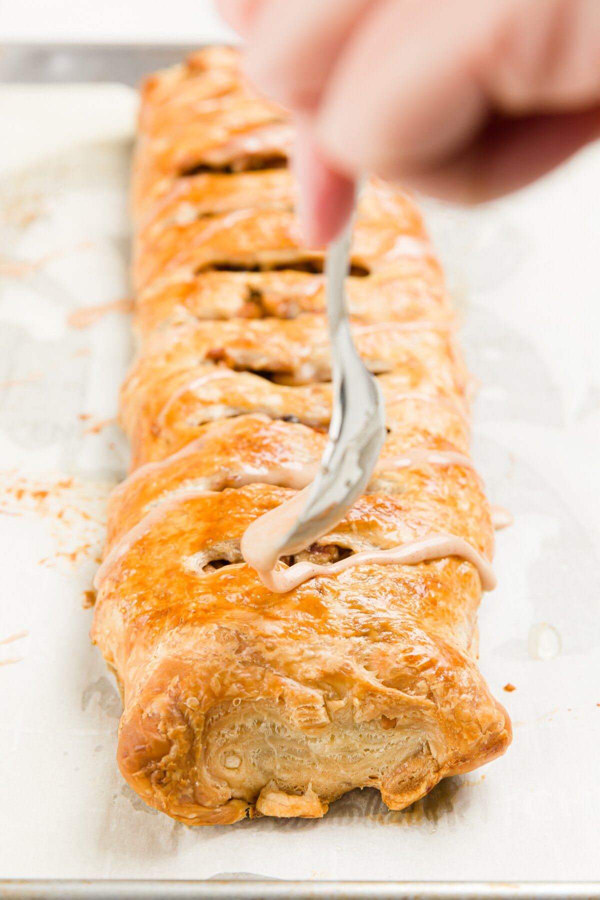 Drizzling glaze on strudel
