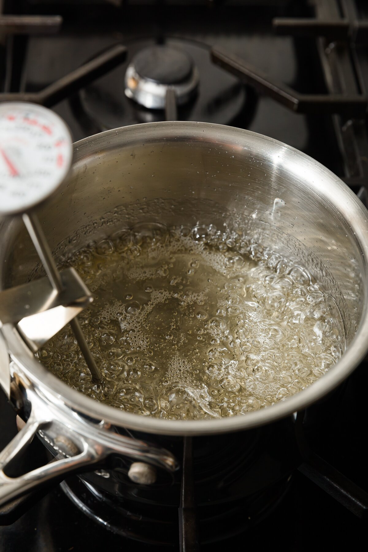 water and sugar boiling in a medium pot on a stovetop
