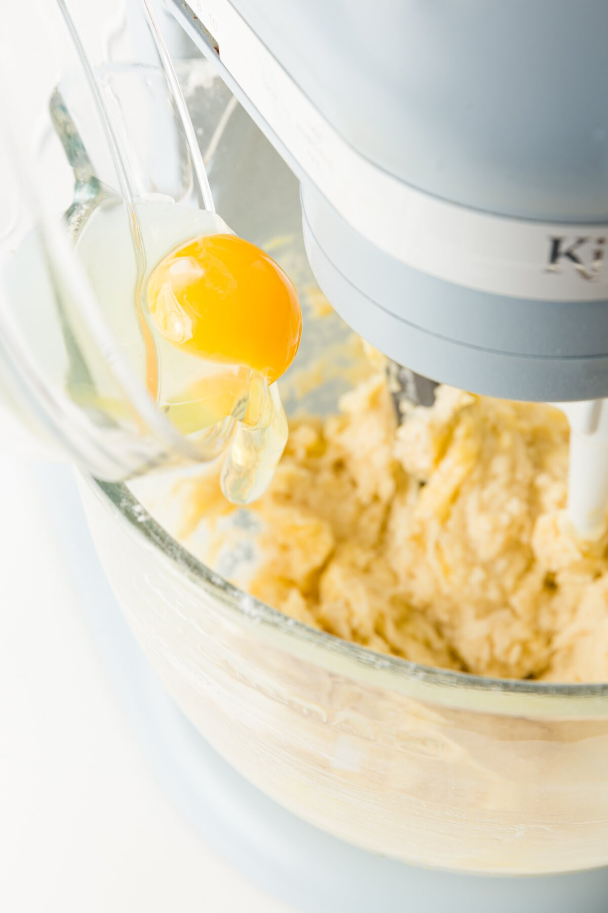 eggs being added into batter in a stand mixer