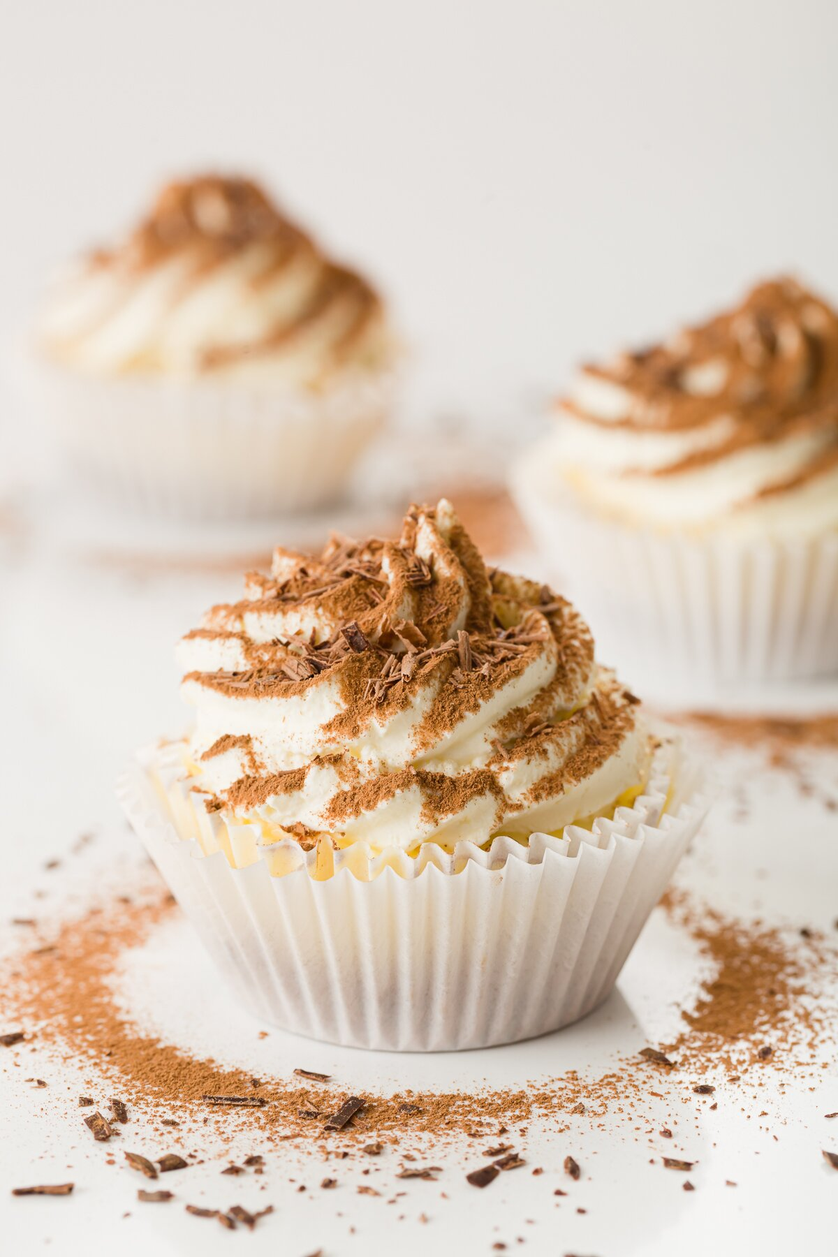 tight shot of a tiramisu cupcake with two others in the background