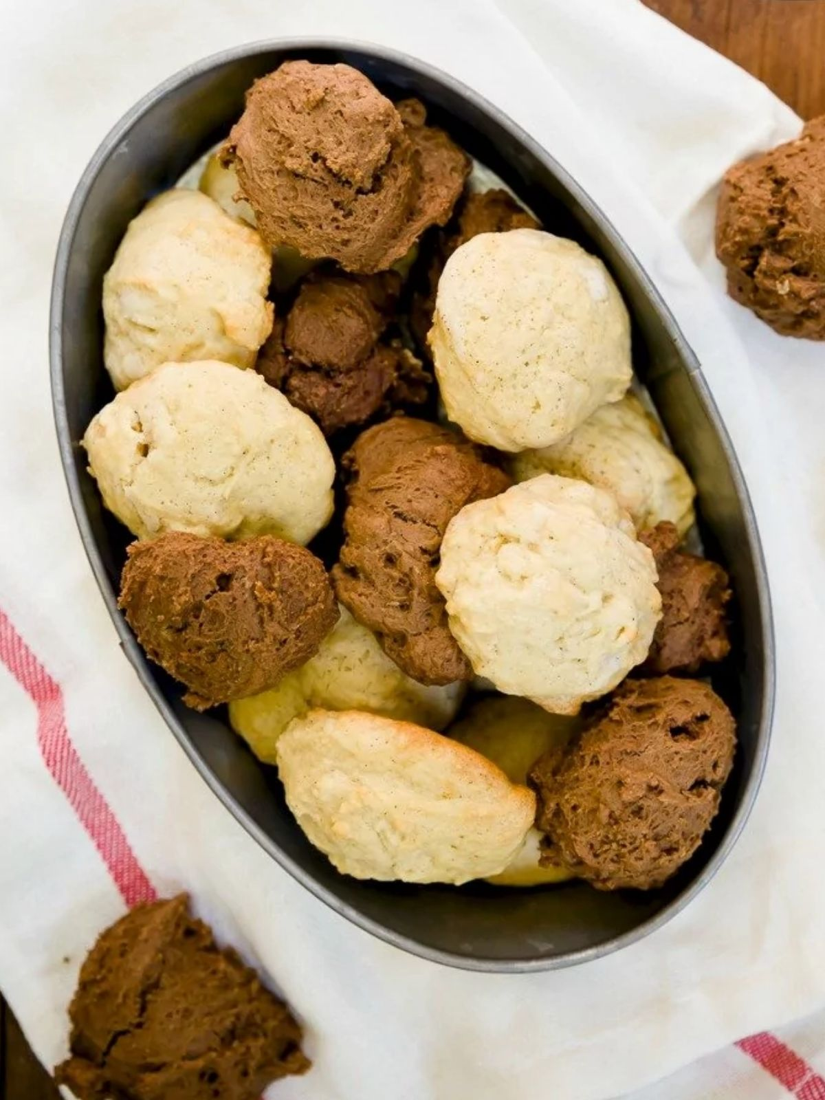 Cookies made from leftover frosting piled into a black rectangular bowl.