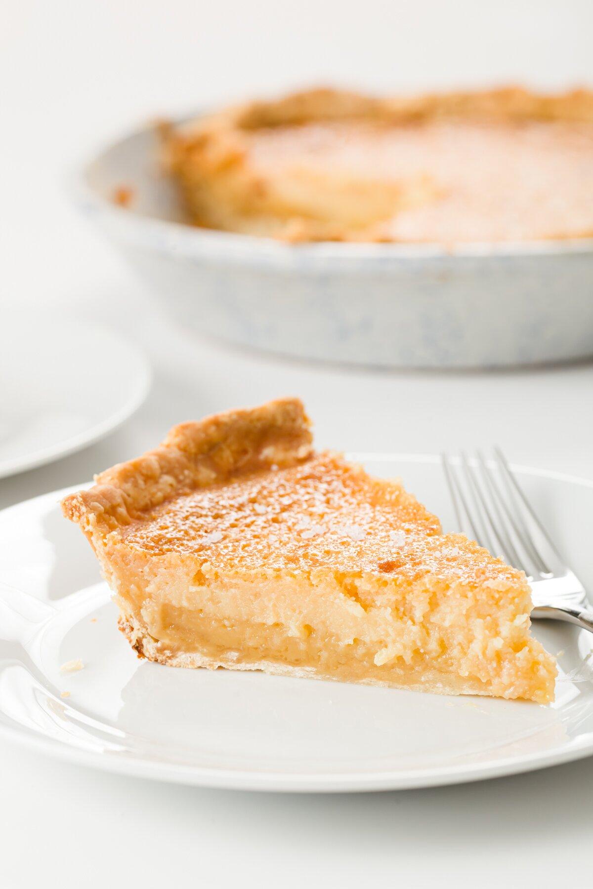 Slice of honey pie on a white plate