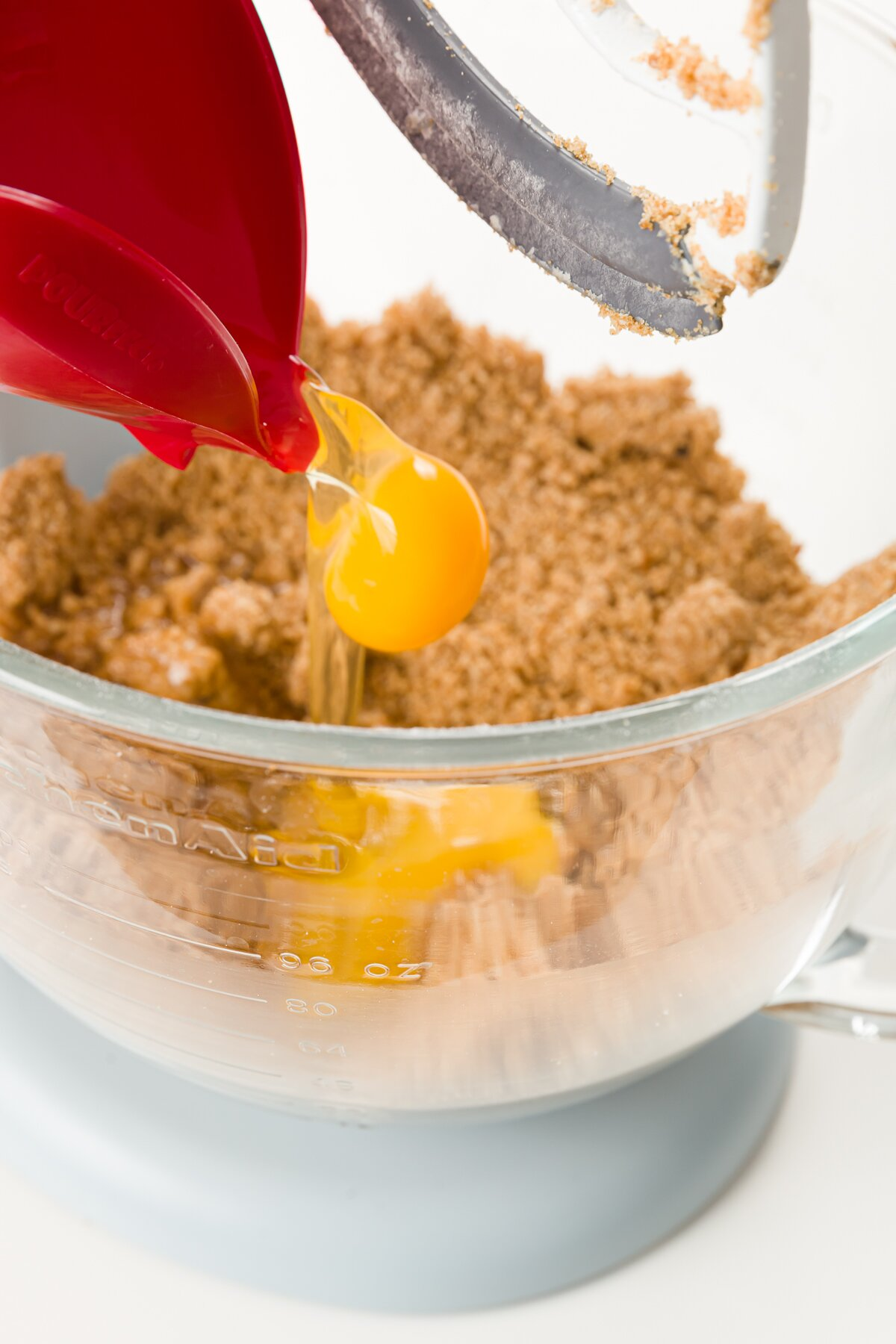 Adding eggs to brown sugar butter mixture