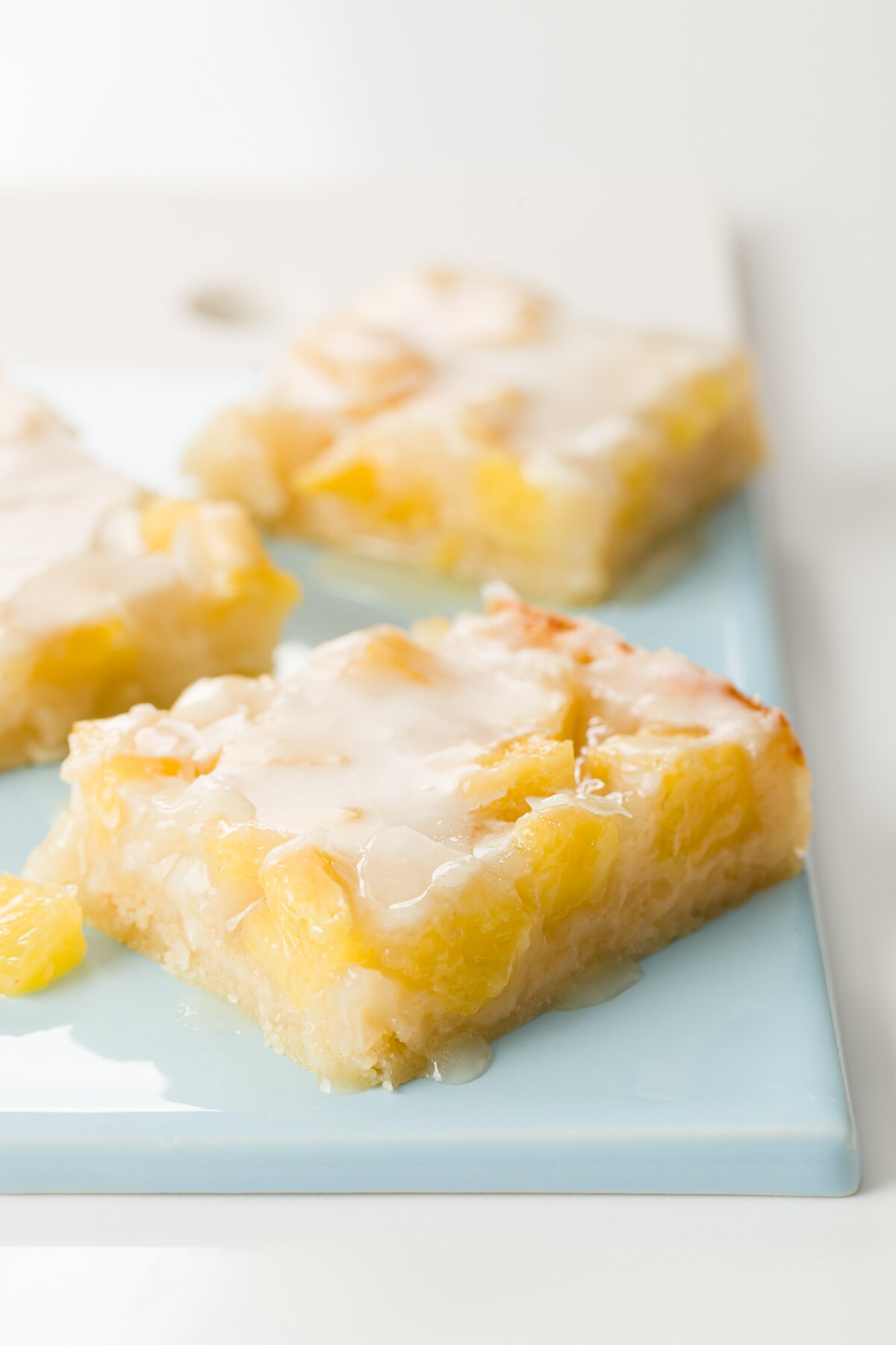A few pineapple bars on a blue serving plate