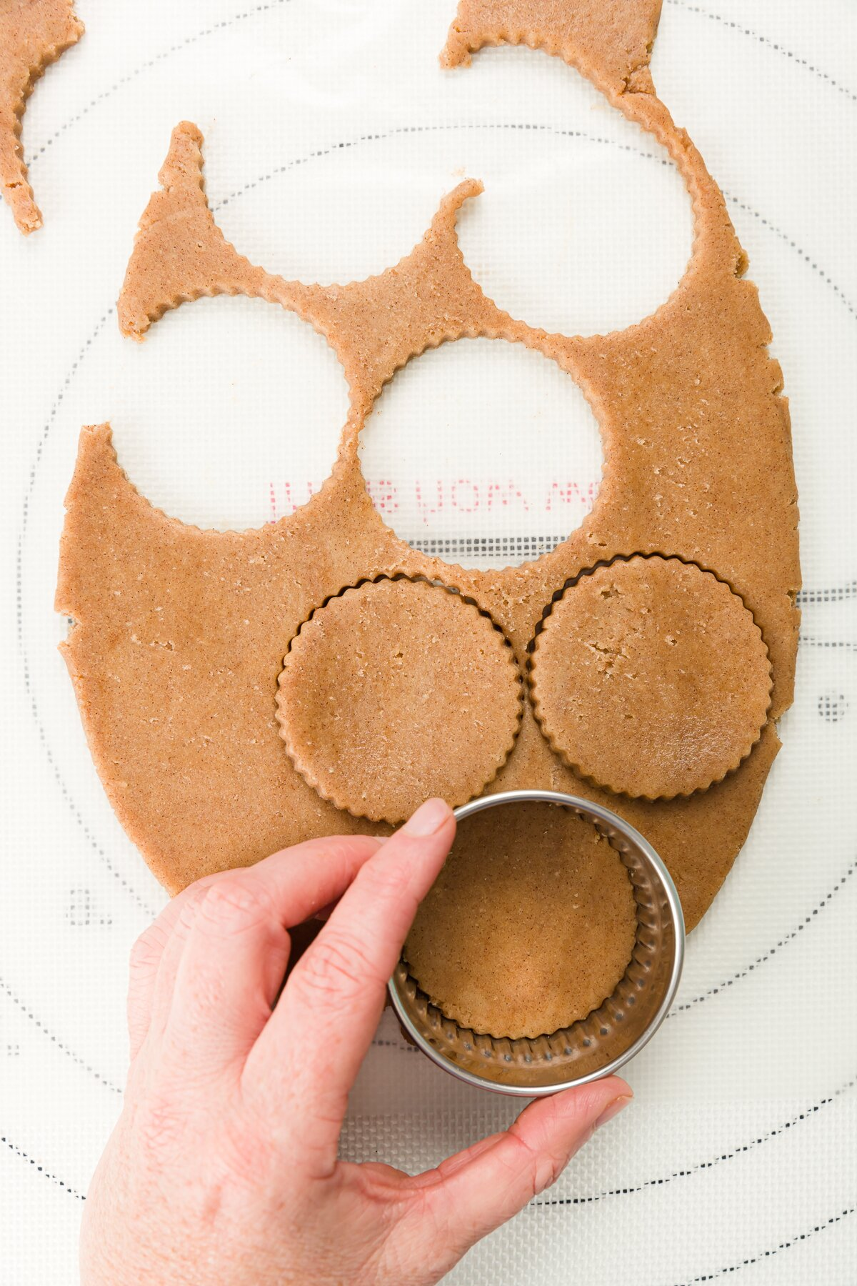 Overhead shot of cutting out circles of cookie dough